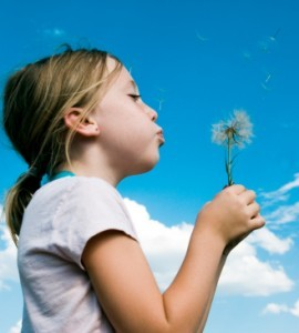 Children-Girl-Blowing-Flower-270x300